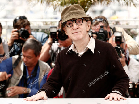 """Woody Allen Filmmaker Woody Allen poses during a photo call for the film """"You Will Meet a Tall Dark Stranger,"""" at the 63rd international film festival, in Cannes, southern France. Allen is busy preparing his latest movie, """"Magic in the Moonlight."""" Continuing his European intrigue, Allen's upcoming film, which is set in southern France and has already begun production, and stars Colin Firth, Emma Stone, Eileen Atkins, Marcia Gay Harden, Hamish Linklater, Simon McBurney, and Jacki Weaver"""