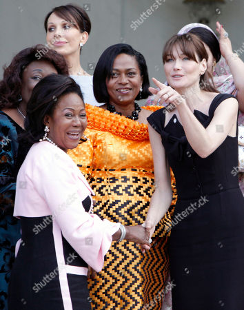 Carla Bruni-Sarkozy, Monique Bozize, Sylvia Bongo Ondimba, Chantal de Souza Yayi, Antoinette Sassou Nguessois French First Lady Carla Bruni-Sarkozy, right, shakes hands with First Lady of Congo Antoinette Sassou Nguesso, as First Ladies of Central African Republic Monique Bozize, left background, Sylvia Bongo Ondimba of Gabon, background, and Chantal de Souza Yayi of Benin, center, look on as they leave the Elysee Palace, in Paris