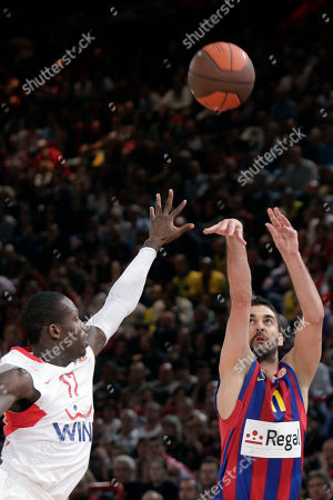 Stock Image of Juan Carlos Navarro, Patrick Beverley Regal FC Barcelona's Juan Carlos Navarro, right, takes a shot, as Olympiacos Patrick Beverley of the U.S., right, tries to block him during their final of the Euroleague Final Four basketball championship at the Palais des Sports of Bercy, in Paris, . Barcelona won 86-68