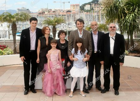 "Actor Costi Dita, left, actress Clara Voda, second from left, actress Carmela Culda, third from left, actress Luminita Gheorghiu, fourth from left, director and actor Cristi Puiu, third from right in back, actress Ileana Puiu, third from right n front, actor Gelu Colceag, right, and an unidentified person, pose during a photo call for ""Aurora"", at the 63rd international film festival, in Cannes, southern France"
