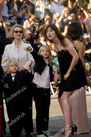 Morgana Davies, Charlotte Gainsbourg Actress Charlotte Gainsbourg, right, and actress Morgana Davies, center, arrive for the awards ceremony at the 63rd international film festival, in Cannes, southern France