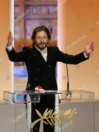 Mathieu Almaric Director Mathieu Almaric reacts after winning the Best Director award during the awards ceremony at the 63rd international film festival, in Cannes, southern France