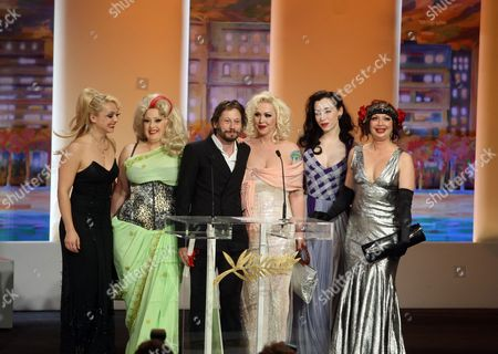 Julie Atlas Muz, Dirty Martini, Mathieu Amalric, Mimi Le Meaux, Evie Lovelle, Kitten on the Keys Director Mathieu Amalric, third from left, accepts the award for Best Director onstage with actresses, from left, Julie Atlas Muz, Dirty Martini, Mimi Le Meaux, Evie Lovelle and Kitten on the Keys during the awards ceremony at the 63rd international film festival, in Cannes, southern France