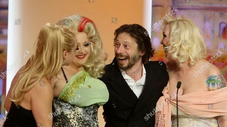 Julie Atlas Muz, Dirty Martini, Mathieu Amalric, Mimi Le Meaux Director Mathieu Amalric, third from left, accepts the award for Best Director onstage with actresses, from left, Julie Atlas Muz, Dirty Martini and Mimi Le Meaux during the awards ceremony at the 63rd international film festival, in Cannes, southern France