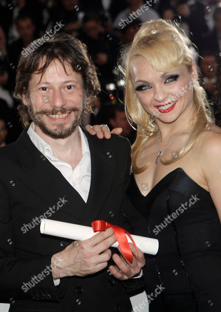 Mathieu Almaric, Julie Atlas Muz Director Mathieu Almaric, left, poses for photographers after winning the Best Director award with actress Julie Atlas Muz, right, during a photo call following the awards ceremony at the 63rd international film festival, in Cannes, southern France