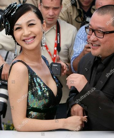 "Wang Xiaoshuai, Li Feier Director Wang Xiaoshuai, right, and actress Li Feier, left, pose for photographers during a photo call for ""Chongqing Blues"", at the 63rd international film festival, in Cannes, southern France"