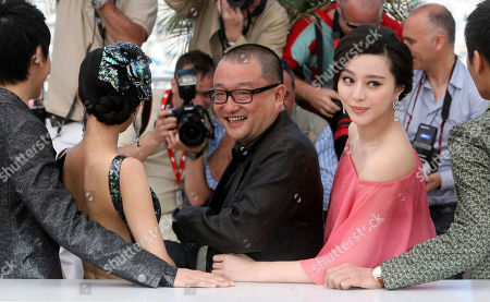 "Zi Yi, Li Feier, Wang Xiaoshuai, Fan Bingbing, Qing Hao From left to right, actor Zi Yi, actress Li Feier, director Wang Xiaoshuai, actress Fan Bingbing, and actor Qing Hao pose for photographers during a photo call for ""Chongqing Blues"", at the 63rd international film festival, in Cannes, southern France"