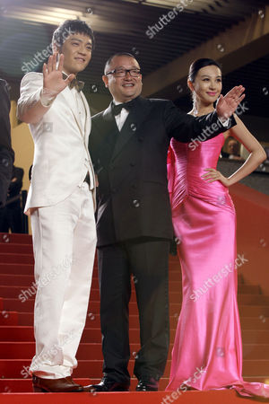 "Zi Yi, Wang Xiaoshuai, Li Feier From left, Actor Zi Yi, director Wang Xiaoshuai and actress Li Feier arrive for the screening of ""Chongqing Blues"", at the 63rd international film festival, in Cannes, southern France"