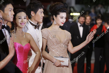 "Qing Hao, Li Feier, Zi Yi, Fan Bingbing From left, actors Qing Hao, Li Feier, Zi Yi and Fan Bingbing arrive for the screening of ""Chongqing Blues"", at the 63rd international film festival, in Cannes, southern France"
