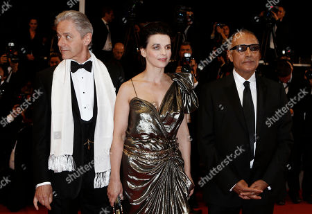 """William Shimell, Juliette Binoche, Abas Kiarostami From left, actor William Shimell, actress Juliette Binoche and director Abas Kiarostami arrive for the screening of the film """"Copie Conforme"""", at the 63rd international film festival, in Cannes, southern France"""