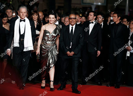 """William Shimell, Juliette Binoche, Abbas Kiarostami From left, actor William Shimell, actress Juliette Binoche and director Abbas Kiarostami arrive for the screening of the film """"Copie Conforme"""", at the 63rd international film festival, in Cannes, southern France"""