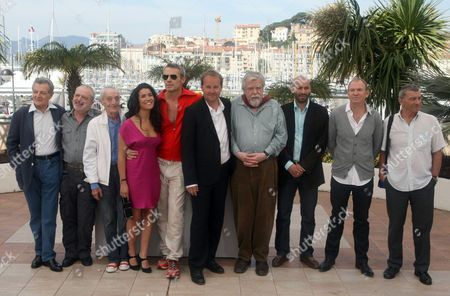 """Phillippe Laundenbach, Jean-Marie Frin, Jacques Herlin, Sabrina Quazani, Adel Bencherif, Xavier Beauvois, Michael Lonsdale, Farid Larbi, Xavier Maly, Loic Pichon From left, actors Phillippe Laudenbach, Jean-Marie Frin, Jacques Herlin, actress Sabrina Ouazani, actor Adel Bencherif, director Xavier Beauvois, actors Michael Lonsdale, Farid Larbi, Xavier Maly and Loic Pichon pose during a photo call for the film """"Des Hommes Et Des Dieux"""", at the 63rd international film festival, in Cannes, southern France"""