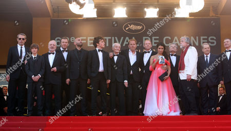 "Xavier Beauvois, Michael Lonsdale, Sabrina Quazani From left, actor Lambert Wilson, two unidentified guests, Olivier Rabourdin, actor Farid Larbi, an unidentified guest, actor Jacques Herlin, director Xavier Beauvois, actor Xavier Maly, actress Sabrina Quazani, actor Philippe Laudenbach, actor Michael Lonsdale, actor Jean-Marie Frin and actor Loic Pichon for the screening of the film ""Des Hommes Et Des Dieux"", at the 63rd international film festival, in Cannes, southern France"