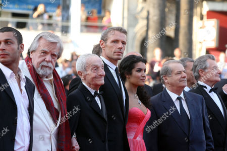 """Adel Bencherif, Michael Lonsdale, Jacques Herlin, Lambert Wilson, Sabrina Quazani, Philippe Laudenbach From left, actor Adel Bencherif, actor Michael Lonsdale, actor Jacques Herlin, actor Lambert Wilson, actress Sabrina Quazani, an unidentified guest and actor Philippe Laudenbach arrive for the screening of the film """"Des Hommes Et Des Dieux"""", at the 63rd international film festival, in Cannes, southern France"""