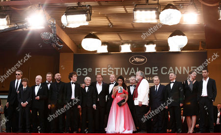 "Lambert Wilson, Xavier Beauvois, Sabrina Quazani From left, actor Lambert Wilson, an unidentified guest, actor Jean-Marie Frin, actor Olivier Rabourdin, actor Farid Larbi, an unidentified guest, actor Jacques Herlin, diretor Xavier Beauvois, an unidentified guest, actress Sabrina Quazani, actor Philippe Laudenbach, actor Michael Lonsdale, three unidentified guests and actor Adel Bencherif arrive for the screening of the film ""Des Hommes Et Des Dieux"", at the 63rd international film festival, in Cannes, southern France"