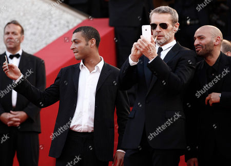 "Adel Bencherif, Lambert Wilson, Farid Larbi Actors, from left, Adel Bencherif, Lambert Wilson and Farid Larbi arrive for the screening of the film ""Des Hommes Et Des Dieux"", at the 63rd international film festival, in Cannes, southern France"