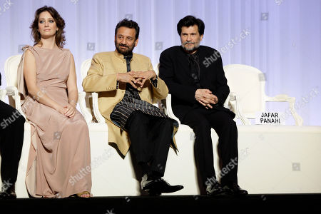 Giovanna Mezzogiorno, Shekhar Kapur, Victor Erice, Jafar Panahi A placard for absent jury member Jafar Panahi, who is currently imprisoned in Iran, is seen, as jury members, from left, Giovanna Mezzogiorno, Shekhar Kapur, Victor Erice, attend the Opening Ceremony, at the 63rd international film festival, in Cannes, southern France