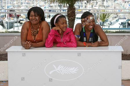 """Stock Photo of Lerato Mvelase, Khomotso Manyaka, Harriet Manamela From left, actresses Lerato Mvelase, Khomotso Manyaka and Harriet Manamela pose during a photo call for the film """"Life, Above All"""", at the 63rd international film festival, in Cannes, southern France"""