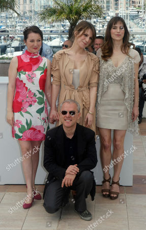 """Lina Berzenteanu, Isabella Ragonese, Stefania Montorsi, Daniele Luchetti Actress Alina Berzenteanu, left, actress Isabella Ragonese, center back, actress Stefania Montorsi, right, and director Daniele Luchetti, foreground, pose during a photo call for the film """"Our Life"""" (La Nostra Vita), at the 63rd international film festival, in Cannes, southern France"""