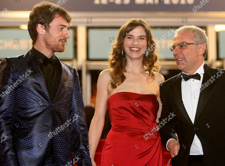"""Elio Germano, Stefania Montorsi, Daniele Luchetti, Isabella Ragonese From left, actor Elio Germano, actress Stefania Montorsi, and director Daniele Luchetti, right, arrive for the screening of """"Our Life"""" (La Nostra Vita), at the 63rd international film festival, in Cannes, southern France"""
