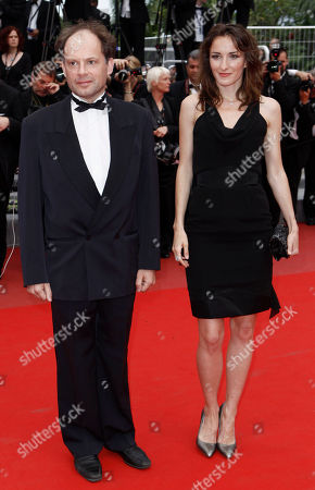 "Denis Podalydes, Salome Stevenin Denis Podalydes and Salome Stevenin arrive for the screening of ""Outside the Law"", at the 63rd international film festival, in Cannes, southern France"