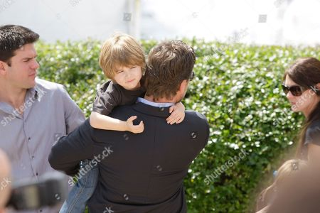 "Russell Crowe Actor Russell Crowe holds his son Charles Spencer Crowe during a photo call for the film ""Robin Hood"", at the 63rd international film festival, in Cannes, southern France"