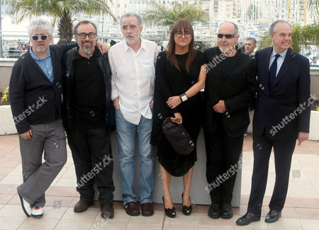 """Pedro Almodovar, Alejandro de la Iglesia, Fernando Trueba, Isabel Coixet From left, filmmaker Pedro Almodovar, filmmaker Alejandro de la Iglesia, filmmaker Fernando Trueba, director Isabel Coixet, an unidentified guest and French Minister of Culture Frederic Mitterand pose during a photocall for """"Spanish Cinema Hommage"""", at the 63rd international film festival, in Cannes, southern France"""