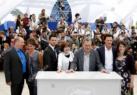 "Moira Buffini, Luke Evans, Stephen Frears, Posy Simmonds, Dominic Cooper, Tamsin Greig From right, actress Moira Buffini, actor Luke Evans, director Stephen Frears, actress Posy Simmonds, actor Dominic Cooper, actress Tamsin Greig and an unidentified guest pose during a photo call for the film ""Tamara Drewe"", at the 63rd international film festival, in Cannes, southern France"