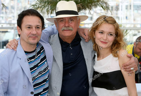 """Oleg Menshikov, Nikita Mikhalkov, Nadezhda Mikhalkova Actor Oleg Menshikov, left, director Nikita Mikhalkov, center, actress Nadezhda Mikhalkova, right, poses during a photo call for """"The Exodus - Burnt by the Sun 2"""", at the 63rd international film festival, in Cannes, southern France"""