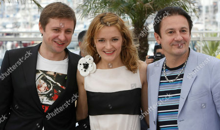 """Artem Menshikov, Nadezhda Mikhalkova, Oleg Menshikov Actor Artem Menshikov, left, actress Nadezhda Mikhalkova, center, and actor Oleg Menshikov, right, pose during a photo call for """"The Exodus - Burnt by the Sun 2"""", at the 63rd international film festival, in Cannes, southern France"""