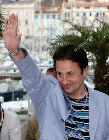 """Oleg Menshikov Actor Oleg Menshikov gestures during a photo call for """"The Exodus - Burnt by the Sun 2"""", at the 63rd international film festival, in Cannes, southern France"""