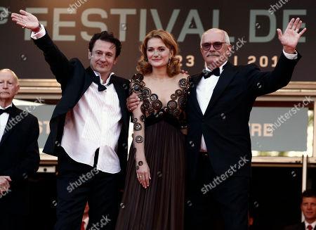 "Oleg Menshikov, Nadezhda Mikhalkova, Nikita Mikhalkov From left, actor Oleg Menshikov, actress Nadezhda Mikhalkova and director Nikita Mikhalkov arrive for the screening of the film ""The Exodus - Burnt By The Sun 2"", at the 63rd international film festival, in Cannes, southern France"