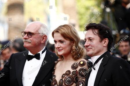 "Nikita Mikhalkov, Nadezhda Mihalkova, Oleg Menshikov From right, actor Oleg Menshikov, actress Nadezhda Mihalkova and director Nikita Mikhalkov arrive for the screening of the film ""The Exodus - Burnt By The Sun 2"", at the 63rd international film festival, in Cannes, southern France"