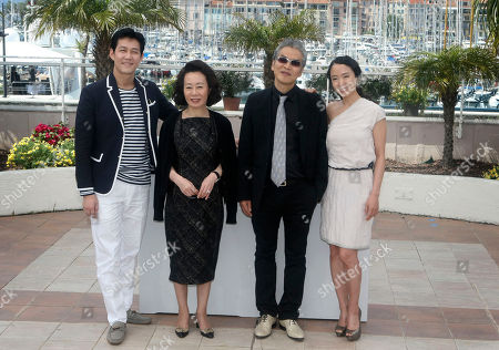 """Lee Jung-jae, Youn Yuh-jung, Im Sang-soo, Jeon Do-yeon From left, actor Lee Jung-jae, actress Youn Yuh-jung, director Im Sang-soo and actress Jeon Do-yeon pose during a photo call for """"The Housemaid"""", at the 63rd international film festival, in Cannes, southern France"""