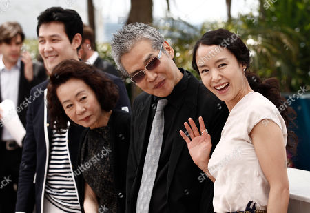 """Lee Jung-jae, Youn Yuh-jung, Im Sang-soo, Jeon Do-yeon From left, actor Lee Jung-jae, actress Youn Yuh-jung, director Im Sang-soo and actress Jeon Do-yeon pose for photographers during a photo call for """"The Housemaid"""", at the 63rd international film festival, in Cannes, southern France"""