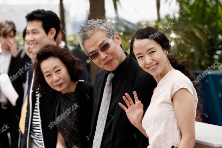 """Lee Jung-jae, Jeon Do-yeon, Youn Yuh-jung, Im Sang-soo From left, actor Lee Jung-jae, actress Youn Yuh-jung, director Im Sang-soo and actress Jeon Do-yeon pose for photographers during a photo call for """"The Housemaid"""", at the 63rd international film festival, in Cannes, southern France"""