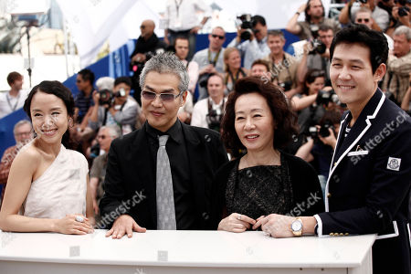 """Jeon Do-yeon, Im Sang-soo, Youn Yuh-jung, Lee Jung-jae From left, actress Jeon Do-yeon, director Im Sang-soo, actress Youn Yuh-jung and actor Lee Jung-jae pose for photographers during a photo call for """"The Housemaid"""", at the 63rd international film festival, in Cannes, southern France"""