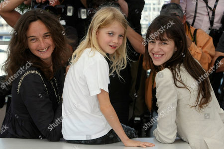 """Morgana Davies, Charlotte Gainsbourg, Julie Bertucelli Director Julie Bertucelli, left, actress Morgana Davies, center, and actress Charlotte Gainsbourg, right, pose during a photo call for """"The Tree"""", at the 63rd international film festival, in Cannes, southern France"""