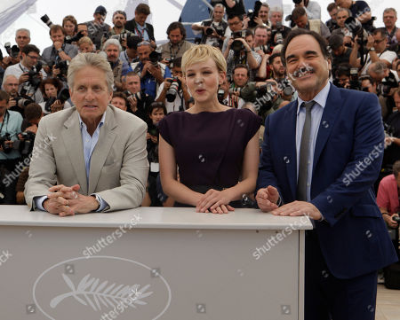 "Carey Mulligan, Michael Douglas, Oliver Stone Actor Michael Douglas, actress Carey Mulligan and director Oliver Stone pose during a photo call for ""Wall Street: Money Never Sleeps"", at the 63rd international film festival, in Cannes, southern France"