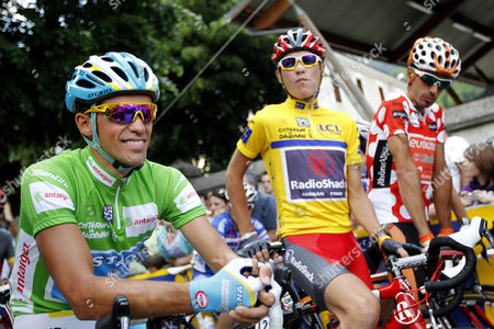 Alberto Contador, Janez Brajkovic, Egol Martinez Astana's Alberto Contador of Spain, left with green jersey, Janez Brajkovic of Slovenia, center with yellow jersey, and Egol Martinez of Spain, right with the best climber jersey, wait for the start of the last stage of the 62nd Dauphine Libere cycling race between Allevard-les-Bains and Sallanches, French Alps