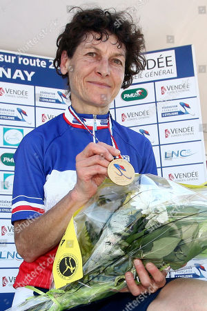Jeannie Longo Jeannie Longo, 51, shows her medal after winning the 24.7 km race against the clock in the French cycling championship in Chantonnay, western France, . Longo won her 10th national title and her 57th title of her career