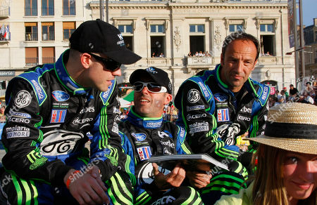 Highcroft Racing drivers Britain's Marino Franchitti, left, Australia's David Brabham, center, and Germany's Marco Werner are seen during a parade on the eve of the 78th 24-hours Le Mans endurance race in Le Mans, western France