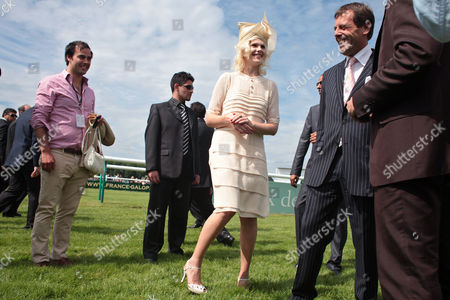 Micky Green Australian pop singer Micky Green, center, is seen during the Prix de Diane horse race, in Chantilly, West of Paris, . Others persons are unidentified