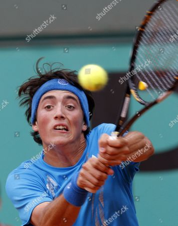 Agustin Velotti Argentina's Agustin Velotti returns the ball to USA's Andrea Collarini during a boy's finals match for the French Open tennis tournament at the Roland Garros stadium in Paris