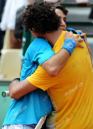 Agustin Velotti, Andrea Collarini Argentina's Agustin Velotti, left, is congratulated by USA's Andrea Collarini after a boy's finals match for the French Open tennis tournament at the Roland Garros stadium in Paris