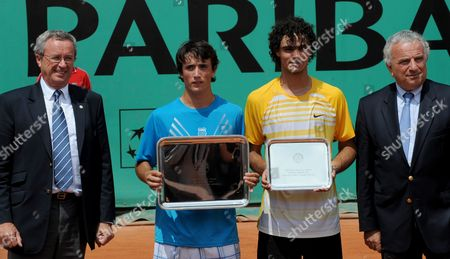 Agustin Velotti, Andrea Collarini Argentina's Agustin Velotti, second left, holds his first place trophy next to runner up USA's Andrea Collarini after a boy's finals match for the French Open tennis tournament at the Roland Garros stadium in Paris
