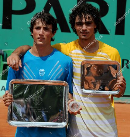 Agustin Velotti, Andrea Collarini Argentina's Agustin Velotti, left, holds his first place trophy next to runner up USA's Andrea Collarini after a boy's finals match for the French Open tennis tournament at the Roland Garros stadium in Paris