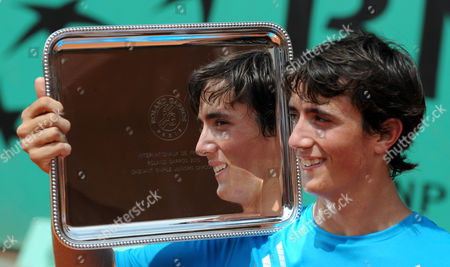 Agustin Velotti Argentina's Agustin Velotti holds his trophy after defeating USA's Andrea Collarini during a boy's finals match for the French Open tennis tournament at the Roland Garros stadium in Paris