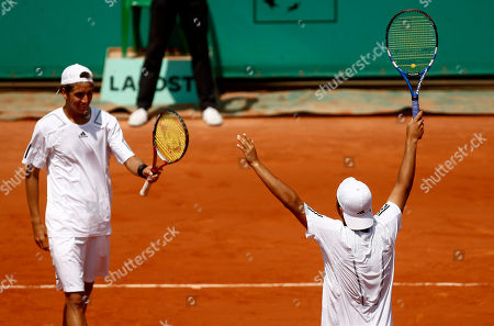 Duilio Beretta, Roberto Quiroz Peru's Duilio Beretta, right, jubilates toward his partner Ecuador's Roberto Quiroz after defeating Argentina's Facundo Arguello and Agustin Velotti during a boy's final doubles match for the French Open tennis tournament at the Roland Garros stadium in Paris
