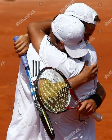 Duilio Beretta, Roberto Quiroz Peru's Duilio Beretta, right, jubilates with his partner Ecuador's Roberto Quiroz after defeating Argentina's Facundo Arguello and Agustin Velotti during a boy's final doubles match for the French Open tennis tournament at the Roland Garros stadium in Paris